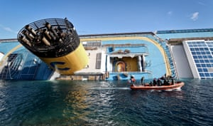 January 15, 2012: A boat sails next to the Costa Concordia off the coast of Giglio Island, where she remained for the next two-and-a-half years