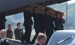 A coffin of one of the victims of Malaysia Airlines MH17 downed over rebel-held territory in eastern Ukraine, is carried from an aircraft during a national reception ceremony at Eindhoven.