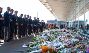 Malaysia Airlines Regional Vice President Huib Gorter, President & CEO KLM Royal Dutch Airlines Camiel Eurlings  and President and CEO of Schiphol Jos Nijhuis pay their respects at Schiphol Airport.