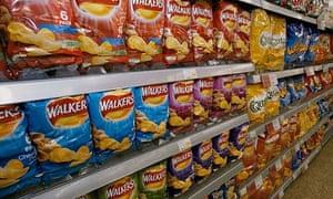 Crisps displayed for sale on a supermarket shelf