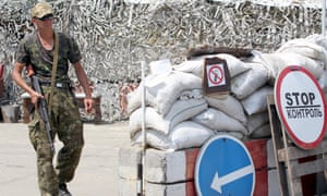 A pro-Russian separatist mans a checkout 25 kilometers from the city of Donetsk.