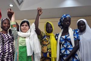 Pakistani education activist Malala Yousafzai, second left, poses with five escaped Chibok schoolgirls, from left,Kanna Bitrus, Hauwa John, Hauwa Musa and Hawa Alhl'ama. Photograph: Isaac Babatunde/AFP/Getty
