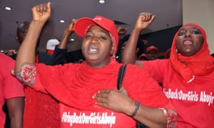 Protesters chant slogans during a press conference after Malala Yousafzai urged President Goodluck Jonathan to meet parents of the  kidnapped schoolgirls.