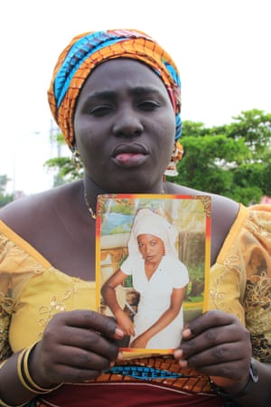 Rebecca Yaga with a picture of her abducted daughter, Sarah, who begged to be allowed to stay in Chibok to sit her exams.
