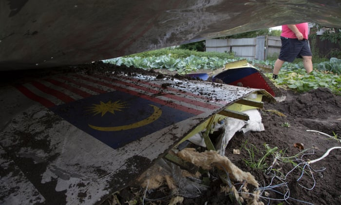 MH17: Bodies arrive in Holland as Ukrainian rebel 'admits