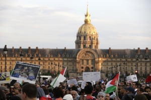 People gather in front of the Invalides during a demonstration on July 23, 2014 in Paris, to denounce Israel's military campaign in Gaza and to show their support to the Palestinian people.