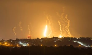 The Israeli community of Netiv Haasara is seen in front of flares fired by the Israeli army in Gaza July 23, 2014.