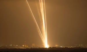 Light streaks and smoke trails are seen as rockets are launched from Gaza towards Israel July 23, 2014.