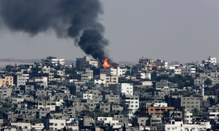 Fire and smoke rises from burning buildings hit by an Israeli air strike in the Shajaiyeh neighborhood of Gaza City.