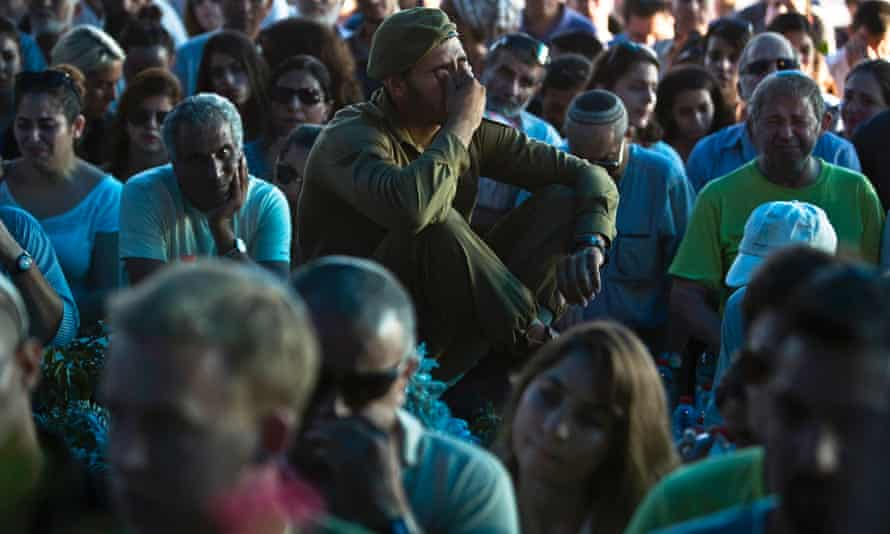 An Israeli soldier mourns during the funeral for Natan Cohen.