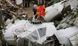 Rescue workers survey the wreckage of TransAsia Airways flight GE222