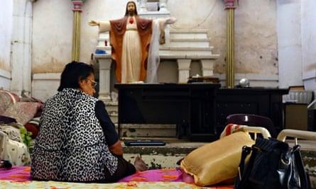 An Iraqi Christian woman fleeing the violence in the Iraqi city of Mosul