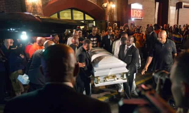 Pallbearers carry the casket of Eric Garner at Bethel Baptist Church.