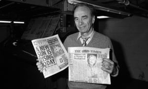 Rupert Murdoch with copies of the Sun and the Times papers at his new print works in Wapping in 1986