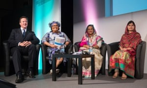 (Left - right) Prime Minister David Cameron, Chantal Compaore the First Lady of Burkina Faso, Sheikh Hasina the Prime Minister of Bangladesh and activist Malala Yousafzai during the Girl Summit 2014 at Walworth Academy, London.