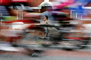 Best TDF 2014: An elderly woman cheers as the pack of riders cycles past