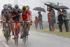 Best TDF 2014: A breakaway group of riders cycle during heavy rain