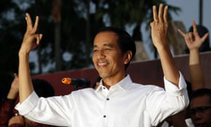 Dictatorship to democracy 17 lessons from indonesia working in joko widodo greets supporters with his three finger greeting symbolising the unity of indonesia during a gathering in jakarta m4hsunfo