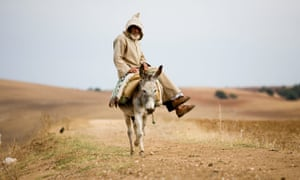 A villager riding a donkey in Morocco's Rif mountains.