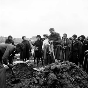 Mourners singing We'll Meet Again and digging in the grave of Andew Shervington, London, 1972.