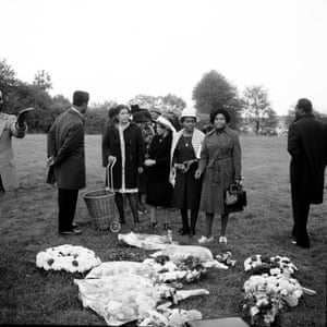 Madame, Miss Icey, Bunty and friends at a funeral. Madame (with shopping trolley) attended the funeral at the last minute, having been told about it whilst out shopping, London, 1970s.