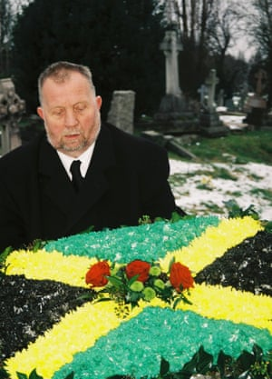 Floral tributes and undertaker at Mussu's funeral, Kensal Green Cemetery, 2012.
