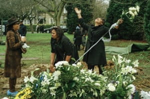 Count Bunney's daughters at their fathers grave after his funeral, 2002.