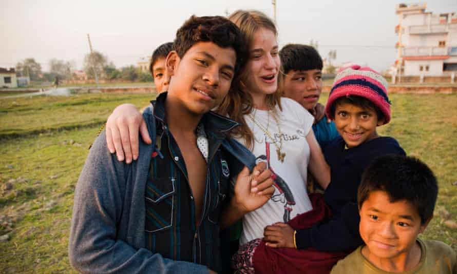 A volunteer with street children in Nepal