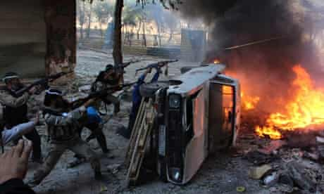 Free Syrian Army fighters fire at forces loyal to Bashar al-Assad in Aleppo
