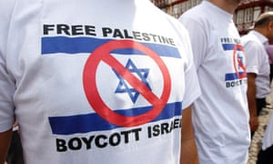 Frankfurt, Germany: Demonstrators wear T-shirts encouraging a boycott of Israel