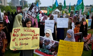 Islamabad, Pakistan: Women and children carry signs calling on Israel to stop the killing in Gaza