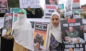 Jammu, India: Shia Muslim women hold placards during a protest