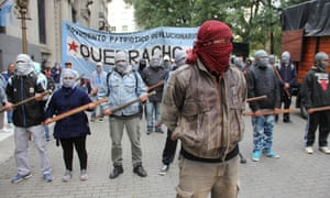 Buenos Aires, Argentina: Masked supporters of the Palestinians demonstrate outside the Israeli embassy