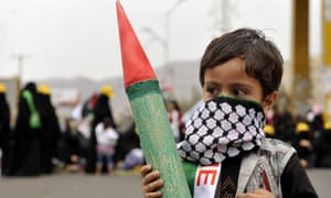 Sana'a, Yemen: A child holds a model of a missile during a protest