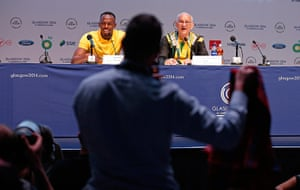 tom jenkins day 3: Usain Bolt is offered a red kilt by a reporter