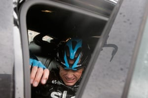 Best TDF 2014: Christopher Froome gets into his team car as he abandons the race