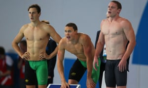 GLASGOW, SCOTLAND - JULY 27:  Thomas Fraser-Holmes of Australia (not in picture) is encouraged by team mates Cameron McEvoy (L), David McKeon (C) and Ned McKendry on the way to winning the gold medal in the Men's 4 x 200m Freestyle Relay Final at Tollcross International Swimming Centre during day four of the Glasgow 2014 Commonwealth Games on July 27, 2014 in Glasgow, Scotland.  (Photo by Quinn Rooney/Getty Images) Commonwealth Games 2014 Swimming topics topix bestof toppics toppix