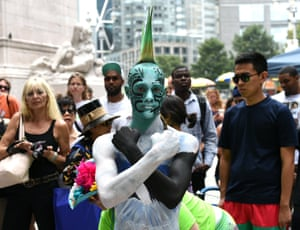 More than 25 body-painting artists from across the U.S. attempt to paint about 30 naked models during an event  at Columbus Circle.