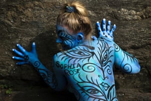 Debbie McCabe, of New Jersey, poses for pictures after being painted at Columbus Circle as body-painting artists gathered to decorate nude models as part of an event featuring artist Andy Golub in New York.