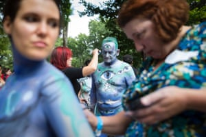 Jack van Riper, of New Jersey, is painted at Columbus Circle as body-painting artists gathered to decorate nude models as part of an event featuring artist Andy Golub in New York.