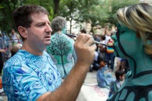 Artist Andy Golub paints a model at Columbus Circle as body-painting artists gathered to decorate nude models as part of an event lead by Golub.