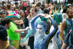 Crist Crow stretches after being painted at Columbus Circle as body-painting artists gathered to decorate nude models as part of an event featuring artist Andy Golub.