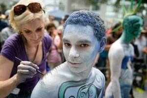 Crist Crow is painted at Columbus Circle as body-painting artists gathered to decorate nude models as part of an event featuring artist Andy Golub.