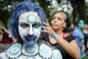 Cully Firmin, of Lafayette, La., is painted at Columbus Circle as body-painting artists gathered to decorate nude models as part of an event featuring artist Andy Golub.