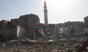 People inspect the destroyed mosque of the prophet Jirjis in Mosul on Sunday.