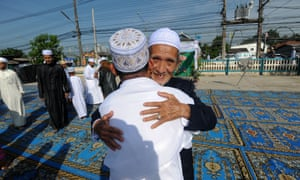 Thai Muslims hug each other after morning prayers at a mosque on the first day of Eid al-Fitr celebrations in Thailand's southern province of Narathiwat, 28 July, 2014.