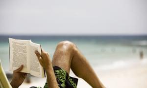 man reading beach