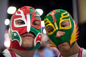 David Urias, 42, and his son Frank Urias, 14, both from Tucson, Arizona, poses for a photograph wearing Mexican wrestling masks