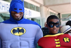 Erien Hodge and his son Adonis Hodge, 13, are dressed as Batman and Robin.
