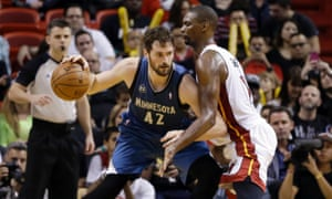 Kevin Love, seen here driving past Chris Bosh of the Miami Heat, might soon be joining Bosh's ex-teammate LeBron James in the Cleveland Cavaliers. Photograph: Alan Diaz/AP